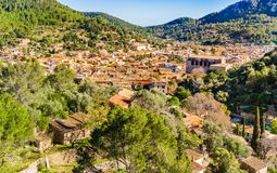 Majorca Spain, view of Esporles town in beautiful rural mountain landscape. View over the roofs of the mediterranean village Esporles on Majorca island, Spain royalty free stock images