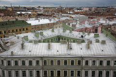 View over the roofs of the old European city. Photo from the top to the streets and rooftops of the old European city (Central district of St. Petersburg, Russia Stock Photos