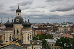 View over the roofs of the old European city. Photo from the top to the streets and rooftops of the old European city (Central district of St. Petersburg, Russia Royalty Free Stock Photography