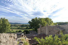 View over the roofs of a small village into the landscape of Pro Stock Image