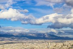View over the rooftops of Athens toward the mountains from the Acropolis with dramatic cloudscape stock images
