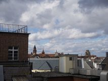 View over the rooftops of a town of stormy weather Stock Images