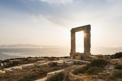 View Over Ruins Of Ancient Marble Doorway Monument Portara At Sunset In Naxos, Greece. Royalty Free Stock Image