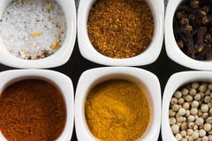 View over several pots with ground spices Stock Photo