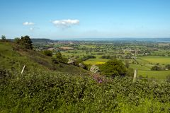 View from The Cotswold Way at Coaley Peak viewpoint, Gloucestershire, UK. View over The Severn Vale from The Cotswold Way long distance footpath at Coaley Peak stock photos