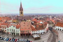 View over Sibiu city in Romania. Wide shot of Sibiu city old town in Romania. The Lutheran Cathedral tower in the middle Stock Photos