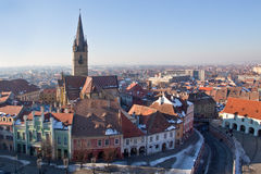 View over Sibiu city in Romania. Wide shot of Sibiu city in Romania during winter. The Reformed Church tower in the middle Stock Photos