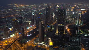 View over skyscrapers lining Sheikh Zayed Road at dusk,. Dubai, Arab Emirates. The road was named after Zayed bin Sultan Al Nahyan first President of the United stock video footage