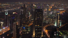 View over skyscrapers lining Sheikh Zayed Road at dusk,. Dubai, United Arab Emirates stock video