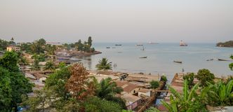 View over slums of Freetown at the sea where the poor inhabitants of this African capital city live, Sierra Leone Stock Photo