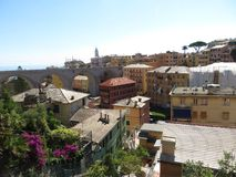 The view over a smaller town near Genoa. Mainly the roofs and a bridge can be seen Stock Photo