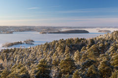 View over snowy trees and frozen lake in Tampere Royalty Free Stock Photo