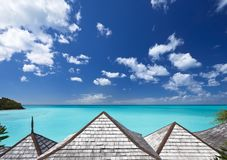 Silver Roofs Overlooking Turquoise Caribbean Sea, Antigua. View over some roofs to the deep turquoise Caribbean Sea under a blue sky Stock Photo