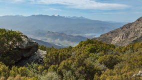 View over St Florent and snow capped mountains in Corsica Stock Image