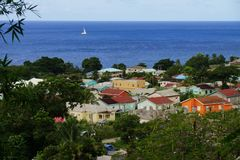 A view over St. Kitts capital, Basseterre with residential buildings and blue sea water on the background Royalty Free Stock Photography