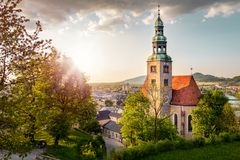 View over Stadt Salzburg with Muelln monastery in the evening in. View over Stadt Salzburg with Muelln monastery church in the evening in summer, Salzburg Royalty Free Stock Images