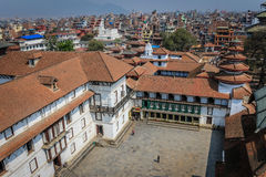 View over temples in Durbar Square, Kathmandu, Nepal. Kathmandu, Nepal - March 23, 2015: Kathmandu's Durbar Square houses the Royal Palace and many historic Stock Images