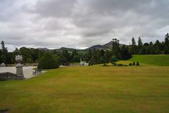 View over the 18th century Powerscourt Gardens with Wicklow mountains in the background. View over the 18th century Powerscourt Gardens on an overcast day with royalty free stock images
