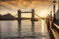 View over the Thames River in London, UK, during a golden sunrise. View over the Thames River in London, UK, to the iconic Tower Bridge, a major tourist stock images