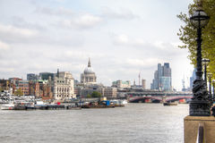View over the Thames with Saint Paul Cathedral. View over the Thames with the Saint Paul Cathedral in the background in London, the capital of the United Kingdom Stock Image