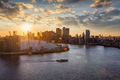 View over the Thames to the skyline of London during sunset time royalty free stock photos