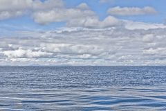 View over Titicaca Lake from a boat. A boats man, fishermen. Roa. D and boat trip to Isla del Sol, Island of the Sun. Located in Lake Titicaca in Bolivia. The Stock Photography