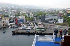View over Torshavn, Faroe Islands. Torshavn, Faroe Islands - June 5, 2014: View over Torshavn, the capital of the Faroe Islands. Men standing at the railing Royalty Free Stock Photography
