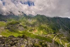View over Transfagarasan Road. Landscape with the winding Transfagarasan road in Fagaras Mountains in Romania in a summer day. One of the most spectacular roads royalty free stock photography