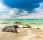 View over a tropical beach with granite rocks, Stock Photos