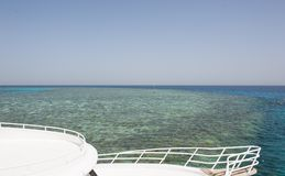 View over a tropical coral reef out at sea Stock Photos