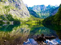 View over turquoise lake in the german alps on alm royalty free stock images