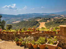 View over Tuscany Hilly Landscape with Pots of Flowers along the royalty free stock image