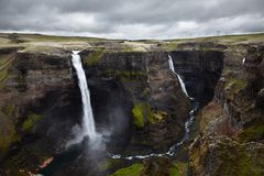 View over two jets of Haifoss waterfall crashing against rocks. View over 2 jets of Haifoss waterfall in South Region, Iceland. Two jets of water are crashing Royalty Free Stock Images