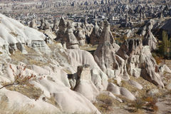 View over valley with cave houses, in Cappadocia, Turkey. View over valley with ancient cave houses in Cappadocia, Turkey, near Goreme, Kayseri and Urgup Stock Photos