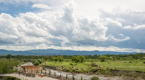 View over the Valley of the Roses, Bulgaria. With a herd of goats and mountains in the background Royalty Free Stock Photo
