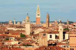 The view over Venice. The view of Venice and the bell tower of St. Mark's square in the distance Royalty Free Stock Photos