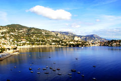 View over Villefranche Côte d'Azur,. Beautiful bay with blue water washes ashore, where a small town located Royalty Free Stock Photography