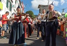 View over the vineyards of the Madeira Wine Company, Estreito de Camara de Lobos, Madeira. Folk music group in local costumes performs  a folk dance at Madeira Stock Image