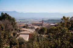 View over vineyards and Sainte Baume in southern France. View over church, vineyards and mountain Sainte Baume in Puyloubier, Provence, Southern France royalty free stock photo