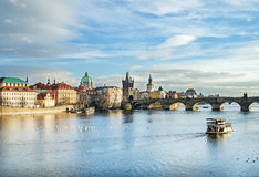 The view over the Vltava river, Charles bridge and white swans f Stock Photos