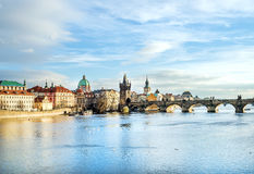 The view over the Vltava river, Charles bridge and white swans f Royalty Free Stock Photography