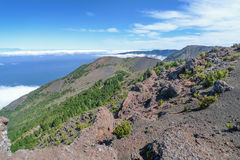 View over the west of El Hierro. On the right the flat Malpaso with mast, behind the rock face of the El Golfo valley. In the background left the island La royalty free stock photography