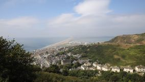 View over Weymouth Portland and Chesil beach Dorset England UK blue sky and cloud stock video