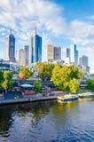 View over Yarra River and City Skyscrapers in Melbourne, Australia. Melbourne, Australia - February 20, 2015: View over Yarra River and City Skyscrapers from Stock Photo