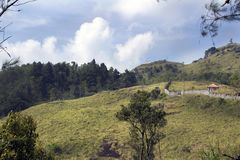 Overlapping lush green ponmudi hills Stock Image