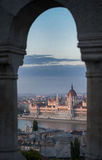 A view overlooking the city of Hungarian Parliament Building and Budapest and the River Danube at pink sunset, Hungary, Europe. Stock Photo