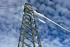 A view of an overlooking high voltage transmission tower under a royalty free stock images