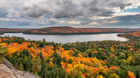 View Overlooking Lake and Changing Fall Trees Stock Image