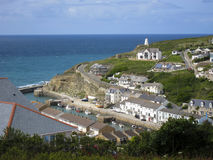 View Overlooking Portreath Harbour and Village, Cornwall. Hillside view looking over the village of Portreath in Cornwall. Scene includes the harbour with Stock Image