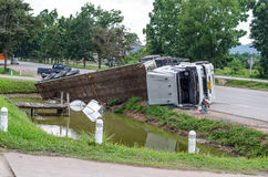 A view of an overturned truck on an highway in an accident.,Thai Royalty Free Stock Image